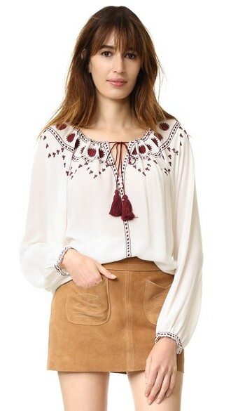 top embroidered tassel