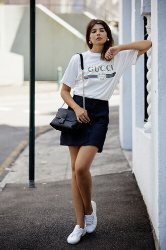 t-shirt gucci gucci t-shirt blak skirt black min skirt skirt white shirt white sneakers sneakers black bag mathys sinclair skirt mathys sinclair loewe superga sneakers superga reliquia earrings reliquia earrings chain bag round earrings bag logo t-shirt loewe bag loewe purse golden earrings