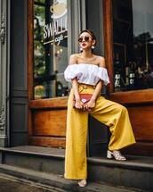 pants,yellow,yellow pants,wide-leg pants,sandals,sandal heels,top,white top,off the shoulder,off the shoulder top,sunglasses,earrings