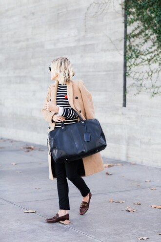damsel in dior blogger striped sweater travel bag weekend escape camel coat loafers