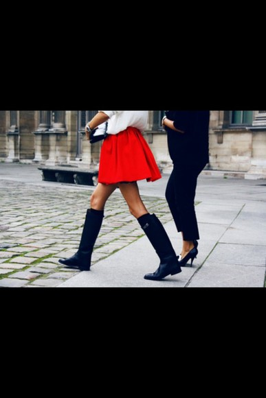 red skirt black shoes long boots white t-shirt