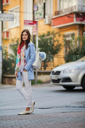 the bow-tie blogger scarf backpack white jeans light blue coat jeans top back to school blue coat white ripped jeans ripped jeans white shoes flats white backpack fur keychain bag accessories