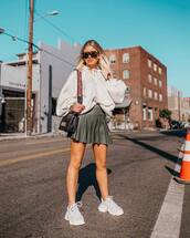 sweater,hoodie,oversized,mini skirt,leather skirt,shoulder bag,mini bag,white sneakers,platform sneakers,balenciaga,sunglasses