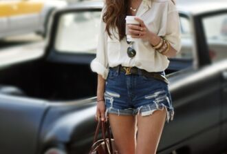 denim shorts shirt blouse top whote shorts accessory fashion jran sunglasses bag bracelets necklace leather ysl belt blous louis vuitton fall outfits coffee cream long hair folded jeans cuffed sleeves white button up top cute