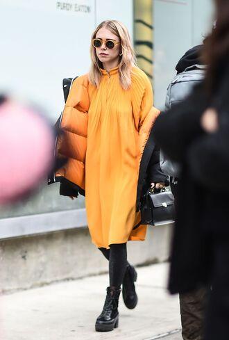 coat nyfw 2017 fashion week 2017 fashion week streetstyle orange orange dress midi dress tights opaque tights boots black boots patent shoes patent boots jacket black jacket puffer jacket sunglasses yellow sunglasses
