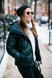 jacket,beanie,white turtleneck sweater,blogger,round sunglasses,green puffer jacket