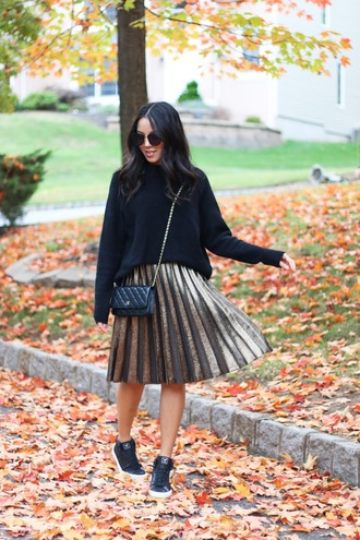 refined couture blogger sweater skirt shoes top sunglasses black sweater fall outfits winter outfits shoulder bag chanel gold skirt pleated skirt black sneakers