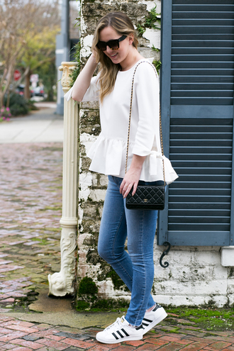 miami + dallas based lifestyle and fashion blog blogger shirt jeans sunglasses ruffled top chanel bag sneakers skinny jeans