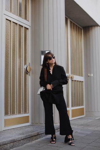 shirt black shirt tumblr pants black pants flare pants sandals sandal heels black sandals bag white bag shoes