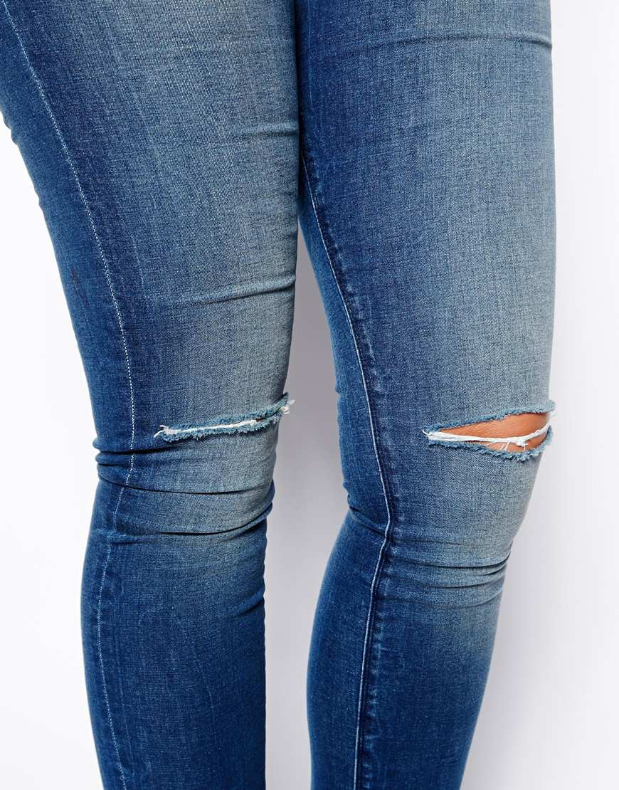 ASOS CURVE Ridley Skinny Jeans In Mid Wash With Ripped Knee at asos.com