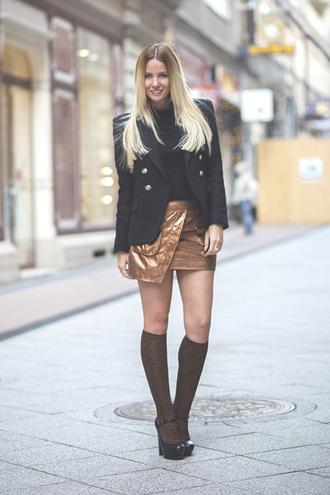 the sense blogger asymmetrical knee high socks black heels blazer
