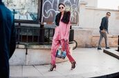 bag,fashion week street style,fashion week 2016,fashion week,paris fashion week 2016,black pants,shirt,pink shirt,matching set,sandals,caged sandals,sandal heels,high heel sandals,black sandals,fur collar,sunglasses,streetstyle,printed bag,tumblr,pajama style,satin shirt