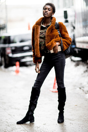 jacket,tumblr,nyfw 2017,fashion week 2017,fashion week,streetstyle,mustard,mustard jacket,fur jacket,faux fur jacket,denim,jeans,black jeans,boots,black boots,flat boots,backpack,black backpack,winter outfits,winter look