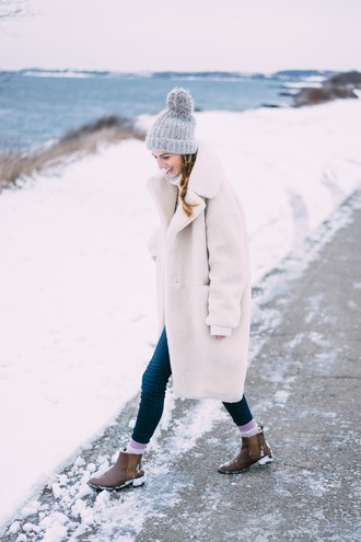 prosecco and plaid blogger coat jeans sweater hat shoes socks beanie grey coat ankle boots winter outfits tumblr white coat white long coat long coat fuzzy coat white fluffy coat teddy bear coat winter coat winter swag winter look grey beanie pom pom beanie denim blue jeans boots brown boots