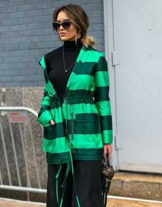 jacket nyfw 2017 fashion week 2017 fashion week streetstyle green jacket striped jacket stripes pants black pants top black top turtleneck black turtleneck top sunglasses necklace
