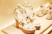 shoes,high heels,sandal heels,white sandal heels,white flower sandal heels,gold buckle