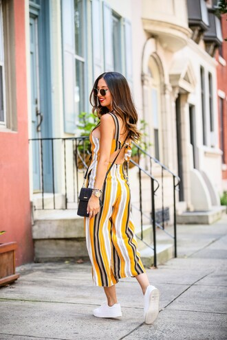 the material girl blogger jumpsuit shoes bag sunglasses fall outfits sneakers crossbody bag striped jumpsuit
