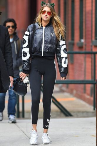 leggings gigi hadid leggings gigi hadid gigi hadid style celebrity style celebrity model streetstyle gym clothes bomber jacket gigi hadid bomber jacket adidas adidas jacket adidas leggings sunglasses aviator sunglasses sneakers white sneakers gigi hadid gym clothes sportswear