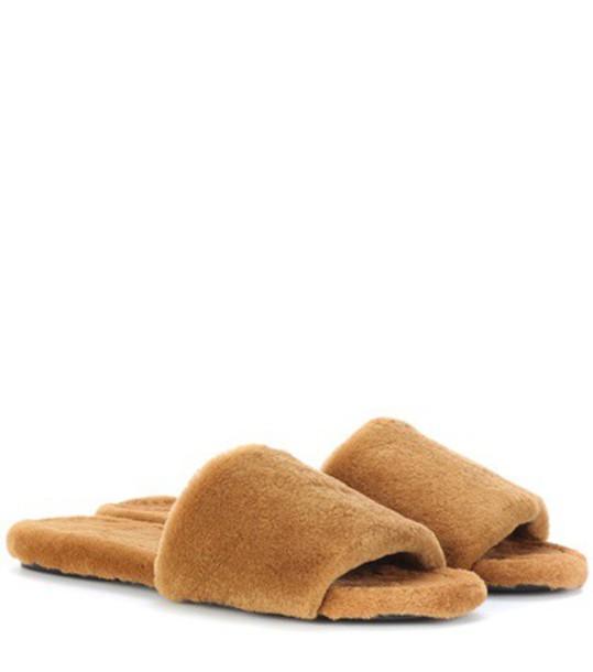 The Row Ellen fur slides in brown