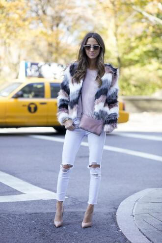 something navy blogger bag sunglasses fur coat fluffy stripes white jeans ripped jeans cropped pants