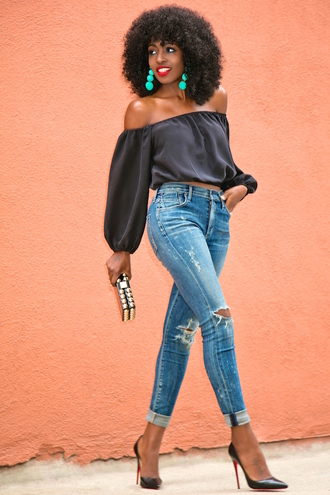 blogger jewels off the shoulder high waisted jeans ripped jeans turquoise black heels louboutin black stilettos long sleeves long sleeve crop top black top black off shoulder top long sleeve romper crop tops black crop top blue jeans earrings statement earrings chic clutch studded cuffed jeans puffed sleeves pompon earrings