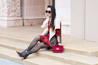 it's not her it's me blogger sunglasses flannel red dress red bag shearling jacket winter outfits dress jacket bag shoes tights shearling vest