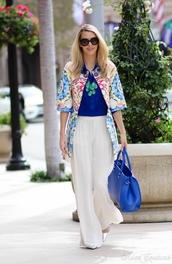 fashion addict,blogger,blue shirt,wide-leg pants,print,white pants,blue bag,pants,jacket,top,bag,shoes,jewels,coat