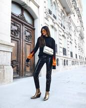 pants,tumblr,black pants,vinyl,leather pants,black leather pants,boots,gold shoes,metallic shoes,metallic,sweater,black sweater,bag,silver bag,chain bag,sunglasses,black vinyl pants,gold boots