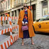 bag,handbag,shoulder bag,coat,pumps,midi skirt,jumper,striped sweater,white shirt,cat eye