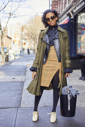 coat nyfw 2017 fashion week 2017 fashion week streetstyle green coat trench coat jacket black jacket leather jacket black leather jacket skirt slit skirt tights opaque tights shoes white shoes top black top bag black bag sunglasses