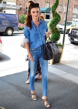 shirt blue jeans leopard print high heels miranda kerr double denim skinny jeans skinny blue jeans blue skinny jeans hermes hermes bag jimmy choo shoes jimmy choo double strap mules black tote denim