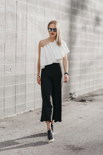 top ruffled top tumblr asymmetrical asymmetrical top ruffle white top pants black pants cropped pants culottes shoes sunglasses