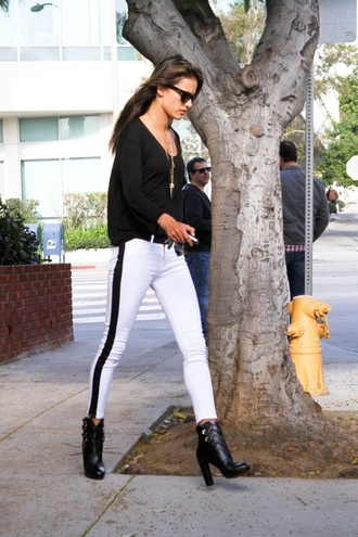 pants shoes necklace blouse side stripe pants white pants alessandra ambrosio celebrity style celebrity model model off-duty skinny pants cropped pants boots black boots high heels boots ankle boots top black top sunglasses black sunglasses
