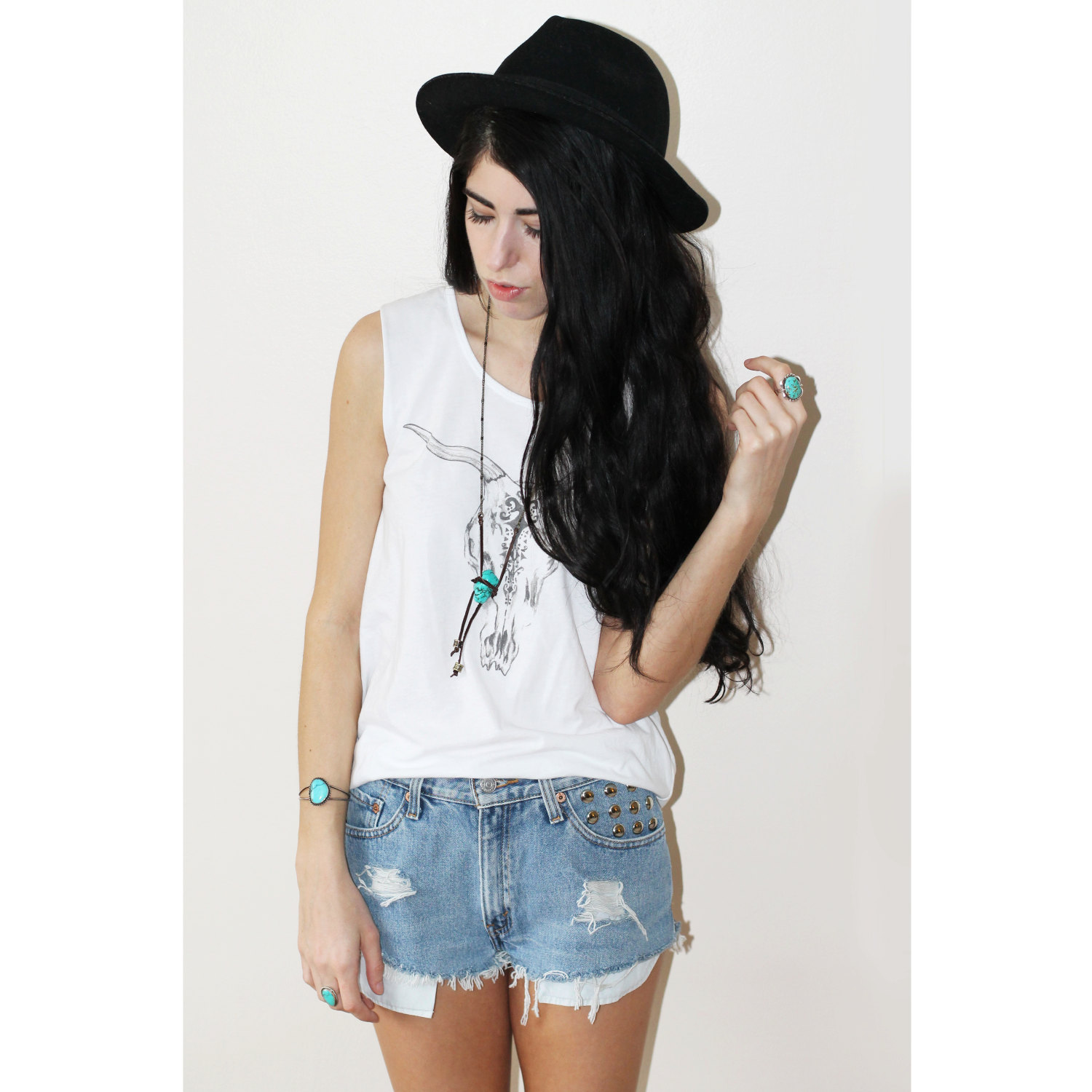Vintage Highwaisted Studded and Distressed Light Levi Shorts.