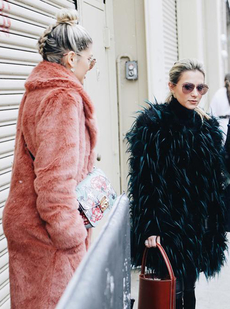 coat nyfw 2017 fashion week 2017 fashion week streetstyle pink coat fur coat hair bun hairstyles green coat brown bag sunglasses aviator sunglasses