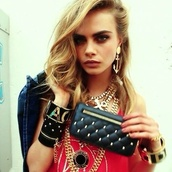 bag,cara delevingne,gold,black,leather jacket,clutch,red,top,shirt,blonde hair,jewels,jacket,blouse