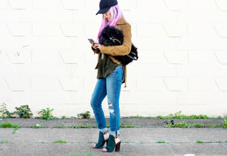 blogger top ripped jeans suede jacket summer boots fuzzy bag black cap pink hair