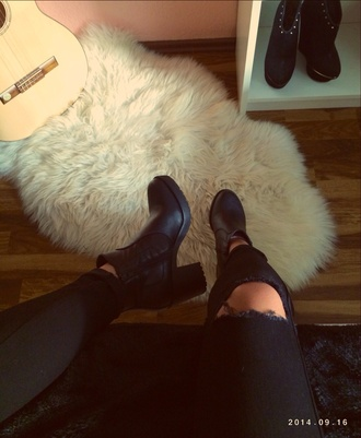 black jeans ripped jeans chelsea boots fur carpet style home decor