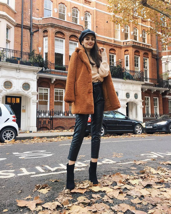 coat orange coat black leather pants black boots pink sweater beret