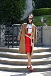 t-shirt,midi skirt,pencil skirt,winter jacket,pumps,blogger,blogger style,slogan t-shirts,coat,skirt,tumblr,white t-shirt,quote on it,camel,camel coat,red skirt,sunglasses,shoes,flats,work outfits,office outfits