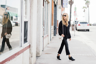 eat sleep wear blogger top jeans shoes bag shoulder bag black blouse cropped bootcut jeans booties all black everything lady 70s style revolve clothing j brand ankle boots kate spade crossbody bag