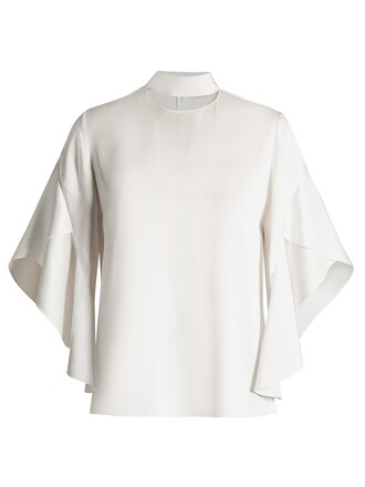 blouse draped white top