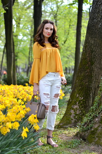 my silk fairytale blogger blouse ripped jeans mustard handbag flat sandals