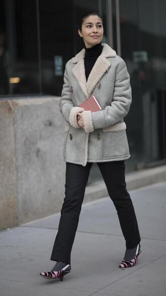 jacket nyfw 2017 fashion week 2017 fashion week streetstyle shearling jacket grey jacket top black top turtleneck black turtleneck top pants black pants socks shoes pumps mid heel pumps