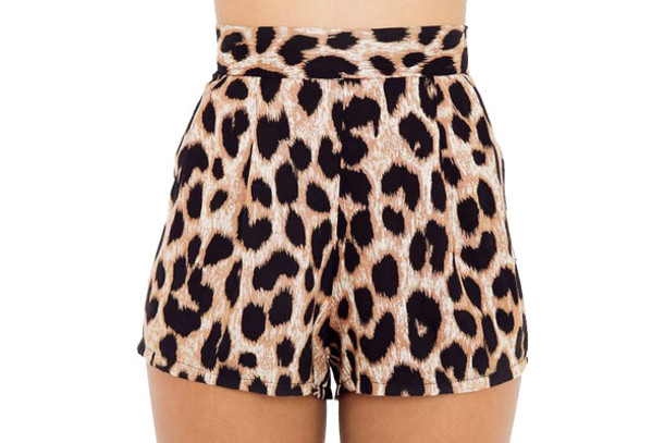 These high-waisted pink leopard print shorts have a black stretch lace waistband and matching lace around the leg. Wear them under skirts, dresses, or shorts for extra leg coverage. This item is part.