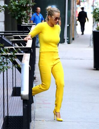 pants all yellow outfit yellow sweater yellow sweater pumps sunglasses streetstyle rita ora yellow pants