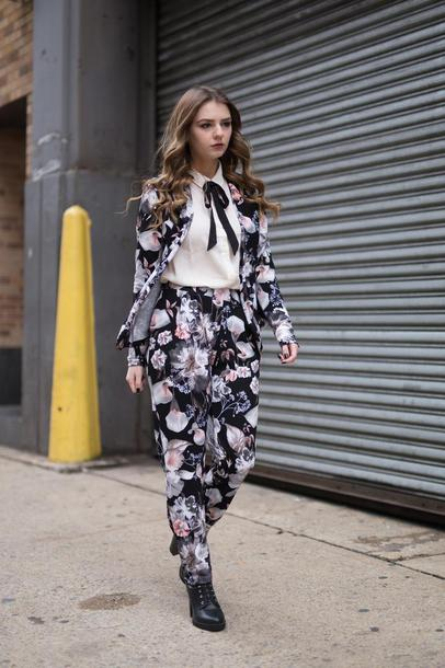 pants nyfw 2017 fashion week 2017 fashion week streetstyle floral floral pants shirt white shirt blazer printed blazer boots black boots high heels boots power suit two piece pantsuits