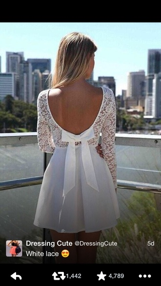 white lace dress with bow in back