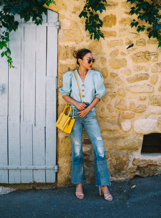 top tumblr blue top puffed sleeves button up bag yellow bag denim jeans blue jeans flare jeans ripped jeans sandals sandal heels high heel sandals shoes