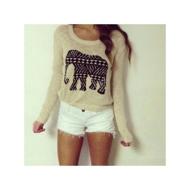 sweater elephant black nude shorts white cozy aztec design elephant print white shorts aztec dress aztec tribal. tribal dress beige cream sweater has a big elephant on the front big elephant blouse beige sweater